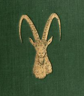 Part of a green book cover with an embossed gold ibex head shown on it.